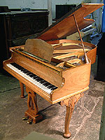 Monington and Weston Baby Grand Piano with a figured walnut case