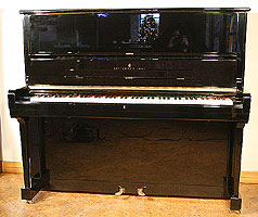 Black Steinway model K upright piano for sale.