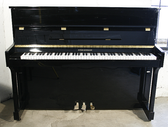 Steigerman upright Piano for sale.