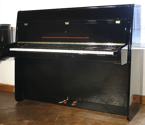 Steinway Model Z upright Piano for sale with a black case.